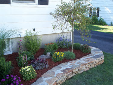 Flower beds can create moisture problems